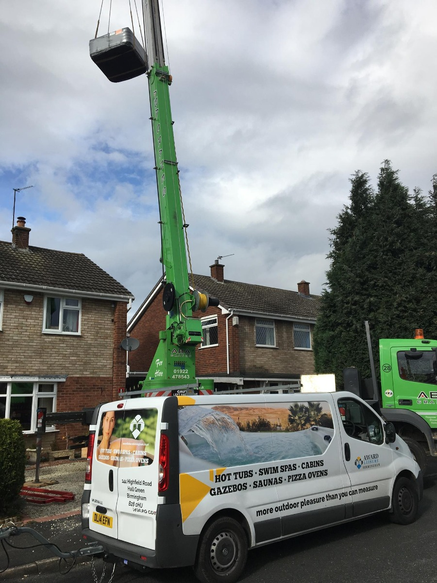 We can crane your Hot Tub over your house to get your spa into position