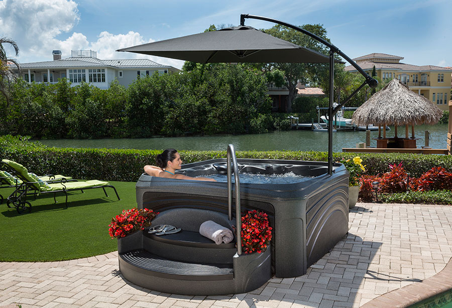 The Award Suite Spa has a built in umbrella for protection and privacy.