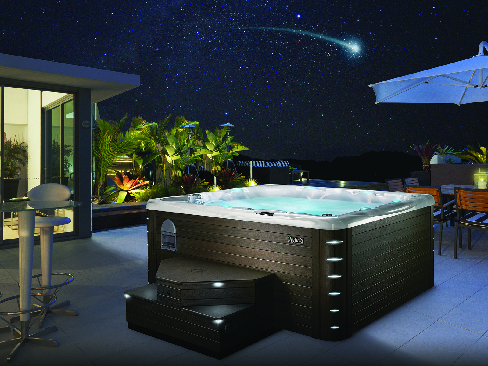 beachcomber hot tub at night lit up