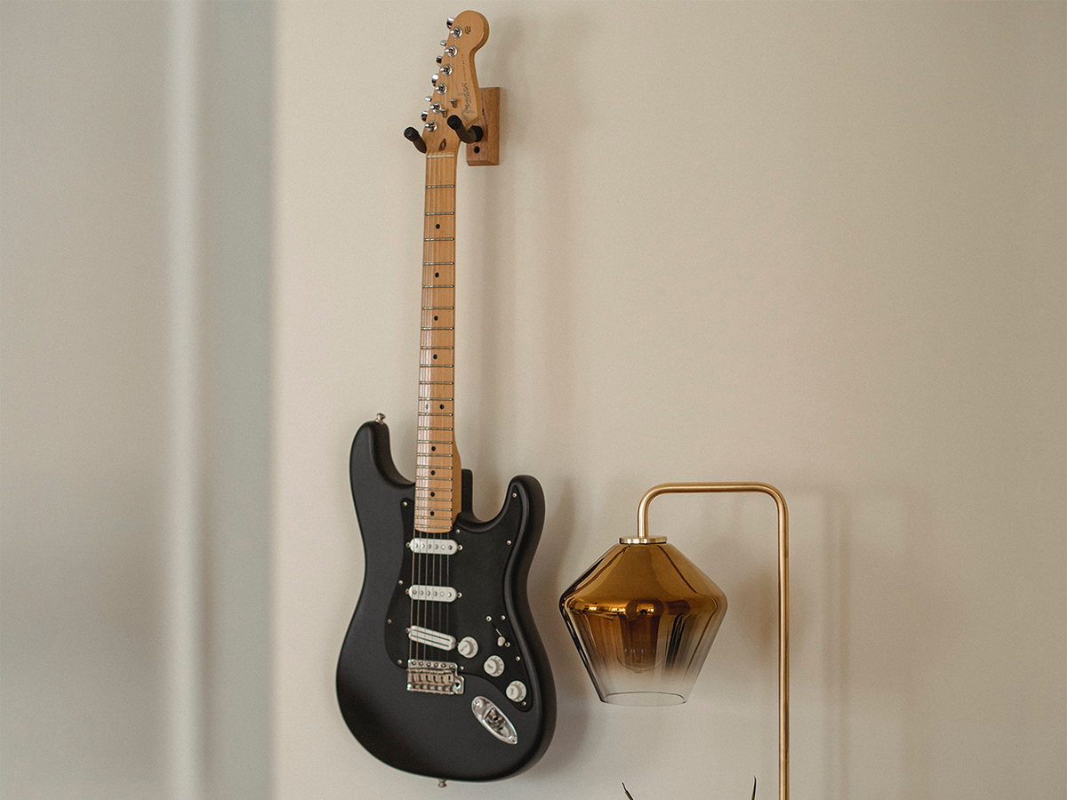 Guitar hanging on wall