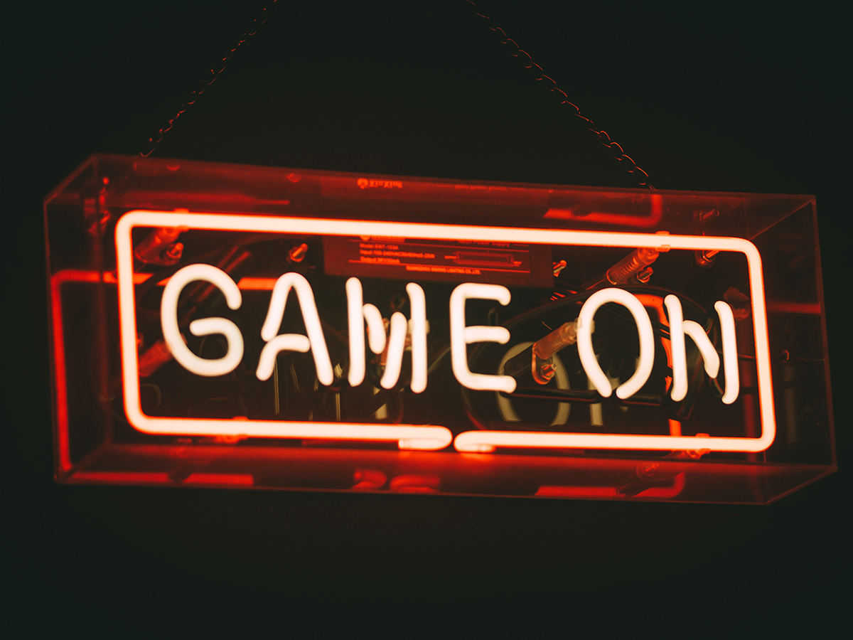 Neon sign that says 'game on'