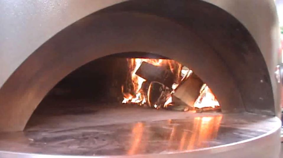 move the fire over to the side of the pizza oven