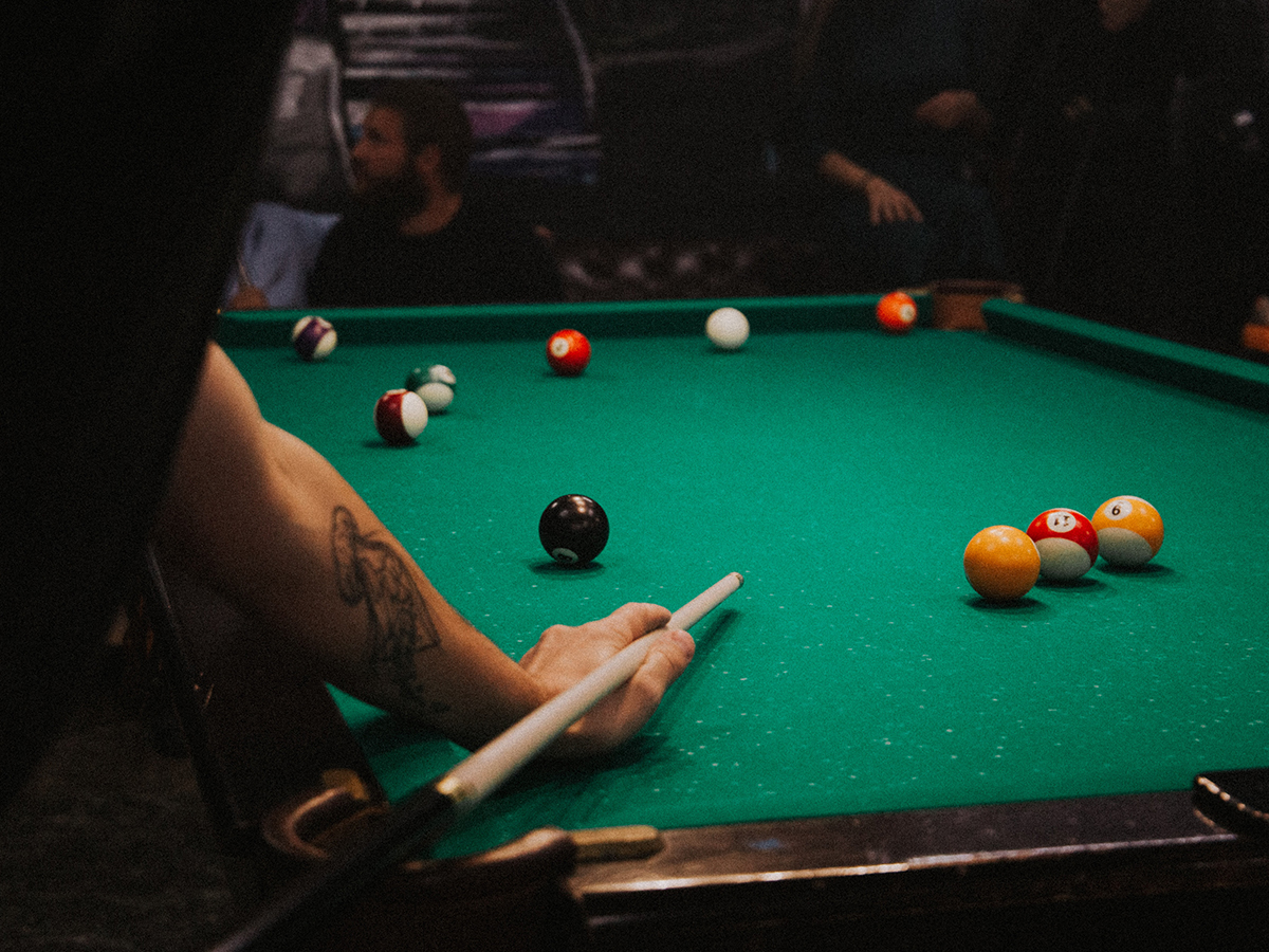 People playing pool